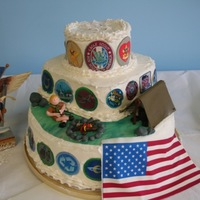 My First Decorated Cake Used butter cream to cover cake, printed photos of merit badges on edible icing flag also. Camping scene made from fondant. The eagle meant...