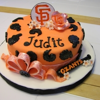 Girly Sf Giants Cake Birthday cake for my cousin who's a big SF Giants fan. Chocolate cake filled with caramel and covered in chocolate ganache and fondant...