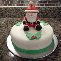 Santa Cake Santa Is Made From Regular Fondant And The Cake Is Covered In Mmf Santa Cake. Santa is made from regular fondant and the cake is covered in MMF.