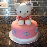 Hello Kitty Birthday Cake   Chocolate cake covered in marshmallow fondant and Hello Kitty is made out of RKT and also covered in marshmallow fondant.
