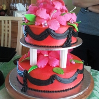 Bold! Chocolate cake with buttercream airbrushed red. Buttercream black swags. Hot pink hibiscus. Yes, this is what the bride asked for. I was...