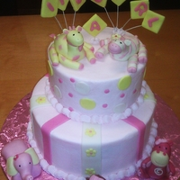 Girl Baby Shower   Buttercream and the animal and made out of gumpaste and fondant