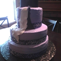 Purple And Black Bridal Cake bottom 2 tiers are red velvet and cream cheese, top tier is carrot cake with cream cheese. Bow tie and bride are made of fondant. cake is...