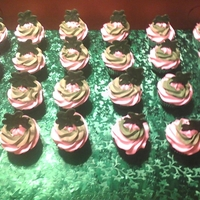 St. Patrick's Day Pistachio Cupcakes pistachio flavored cupcakes with whipped cream frosting topped with a shamrock made from candy melts.