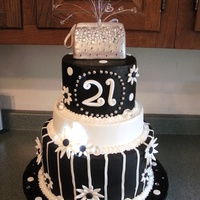 Black And White 21St Birthday 3 tier buttercream with fondant flowers, purse is modeled from rice krispie treats, covered in fondant and painted with edible sugar...