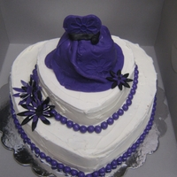 Purple Shower Three layer graduated cake...the dress on top is an actual cake