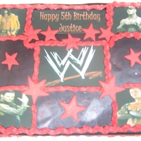 Wrestling 1 11x15 single layer sheet decorated with the birthday guys favorite wrestlers and the logo