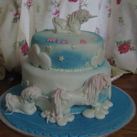 Unicorn moulded unicorn cakes on layered vanilla cakes