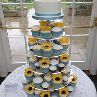 Mixed Cupcakes And A Lemon Sponge Top Cake With Modelling Chocolate Sunflowers Mixed cupcakes and a lemon sponge top cake, with modelling chocolate sunflowers.