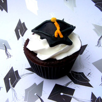 Graduation Hat Cupcakes   Chocolate cake with buttercreme and fondant hats