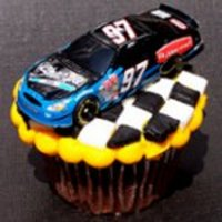 Racecar Cupcake  The car is not real :) but the checkered part I used white and black fondant and cut into strips then squares. I used a buttercreme base...