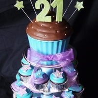 "Blue, Purple And Green Themed 21St Giant cupcake tower for a 21st birthday. Not sure if you can see it, but the toppers spell out ""happy birthday caroline"" I also..."