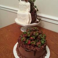 Vanilla Cake With Chocolate And Vanilla Mmf For The Wedding Cake And The Grooms Cake Was Chocolate With Chocolate Buttercream   Vanilla cake with Chocolate and vanilla MMF for the wedding cake and the groom's cake was chocolate with chocolate buttercream.