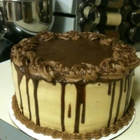 Peanut Butter Ganache Cake   Chocolate cake with a Reese's Peanut butter cup filling with peanut butter frosting drizzled with chocolate ganache