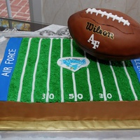 Airforce Football Cake Airforce football field with rice crispy football covered in fondant.