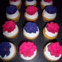 Ruffle Flower Cupcakes   Cupcakes are covered in buttercream, flowers are fondant