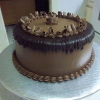Chocolate Cake   Covered in buttercream, chocolate curls are candy melts