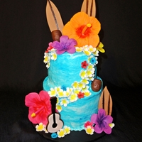 Luau I made this for a luau party! Chocolate and vanilla cake with buttercream icing and fondant decorations!