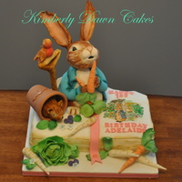 Peter Rabbit Birthday Cake This cake was a joy to make! Maybe because I loved Peter Rabbit as a youngster! Everything on this cake is edible!!! The book page is hand...
