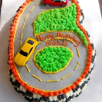 Car Cake 6 yr old boys birthday cake...he love orange and cars :D... Hersheys chocolate cake covered in a chocolate ganache and white chocolate...