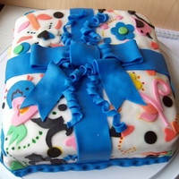 Present Cake Had to practice using fondant on square cakes for my Wilton Class so I made a present cake :D