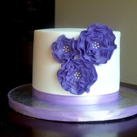 Purple Elegance Elegant smoothed buttercream cake for my Mom's Birthday. My first time trying ruffle flowers, and I LOVE making them!