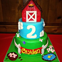 Barnyard Cake This barnyard themed cake matched the party decor perfectly, it was such a fun cake to make!! 8 and 6 inch chocolate cakes with oreo mousse...