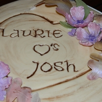 Tree Stump Bridal Shower Cake This is a 10in marble cake w/chocolate BC covered in fondant. Tree roots were made from RKT. The flowers & leaves are gumpaste and...