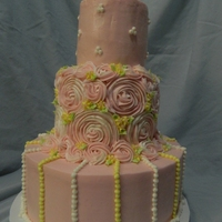 Buttercream Rose Swirls In Pink This is part of a cake trio I made for my Grandmother's 90th birthday party. This one is 3 tiers of vanilla--2 with raspberry filling...