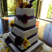 Modern Wedding Cake With Dark Purple Accents 4 tier square wedding cake. Buttercream with piping, sugar pearls and quilting.