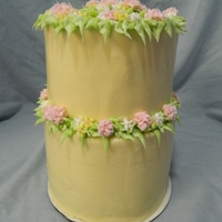 Tall 2-Tier Floral Birthday Cake In Pink & Yellow Tall 7in spice cake topped with a 6in spice cake. Cream cheese frosting w/buttercream leaf & flower border. The cake will be displayed...