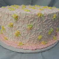 Cornelli Lace Birthday Cake In Pink 10in Chocolate WASC w/caramel filling. White buttercream with pink cornelli lace & yellow accent flowers. This cake is part of a trio...