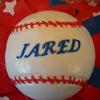 "All American Baseball Cake Fondant covered ""gift"" box with a baseball bursting out of the ""torn"" paper at the top. Ball made with the Wilton ball..."