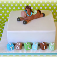 Edible Pony And Blocks For A 1St Birthday Cake Was Chocolate Mud Cake Covered With Chocolate Ganache And Then Fondant Pony And Blocks A  Edible pony and blocks for a 1st Birthday. Cake was chocolate mud cake, covered with chocolate ganache and then fondant. Pony and blocks...