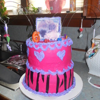 Zebra Bieber Cake 6th birthday cake 4 layer cake wasc, with strawberry filling. all buttercream