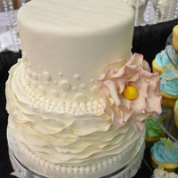 "This Cake Was Created For A Bridal Show I Attended I Won Brides Favorite Booth At This Show Fondant Icing Ruffles And Beading Gumpast This cake was created for a bridal show I attended. I won ""brides favorite booth"" at this show. Fondant icing, ruffles and..."