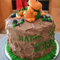 Dino Birthday handmade gumpaste dino and rocks.