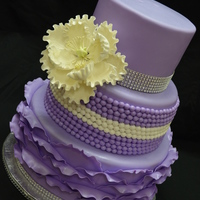 Purple And Bling This cake was created for my cousin for her 30th birthday. Hard to see in the pics but the entire cake has been sprayed with edible pearl...