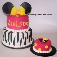 Pink And Yellow With A Little Zebra   This is buttercream with fondant accents. LOVE the color combo