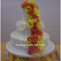 Classic Drapes   This cake is all buttercream with fresh flowers