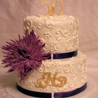 Hayward 50Th   This is all buttercream with hand piped scroll work and gold dusted gumpaste monogram/number.