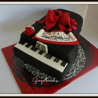 Grand Piano Cake This cake was for a girl who loved to play the piano and her signature color is red. Loved doing this cake!