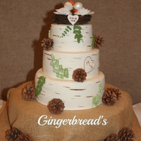 Rustic Wedding Cake For an outdoorsy couple. They wanted a rustic, elegant cake. Doves are handmade as well.
