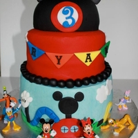 Mickey Mouse Clubhouse vanilla almond bottom tier, chocolate, chocolate chip on top two tiers