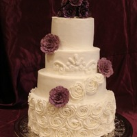 Plum Wedding Cake With Buttercream Rosettes all buttercream. gumpaste roses. elegant romantic cake