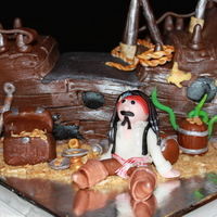 Pirate Cake from Debbie Brown's Enchanted cakes book... the sunken pirate ship and Captain Jack. We tried Duff's chocolate fondant and it is...