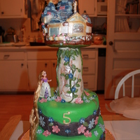 Tangled Cake -2 this is a second tangled cake we made for a birthday party. 10 and 8 inch cakes with center pole and base of tangled tower and tower are...