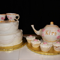 Tea Party Shower tea pot is rice crispy . 10 and 8 in rounds, wasc and almond buttercream. tea cups are gumpaste molded on greased back side of mini doll...
