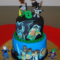 Lego Batman/ Star Wars Cake Used a combination of Edible Images, Fondant, and toys to decorate this one.