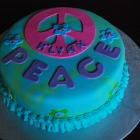 Peace Cake All fondant decorations. Peace sign was cut from a stencil I made. the base was marbled.